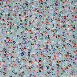 Mousseline polyester satiné fleurs de paradis vert d'eau rayé ajouré irisé