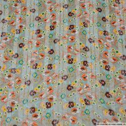 Mousseline polyester satiné épopée florale vert de gris rayé ajouré irisé