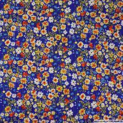 Crépon viscose jeter des fleurs fond violet-bleu lurex
