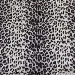 Satin de polyester imprimé léopard sépia