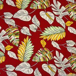 Coton imprimé herbier fond rouge