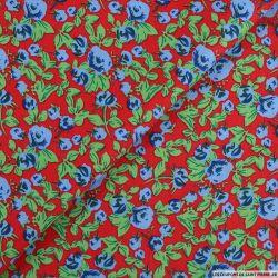 Coton imprimé fleurs en pagaille fond rouge