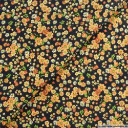 Coton imprimé vivre sans complexe orange fond noir