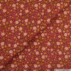 Coton imprimé fort comme une fleur fond bordeaux