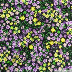 Coton imprimé libérer les fleurs mauve fond noir