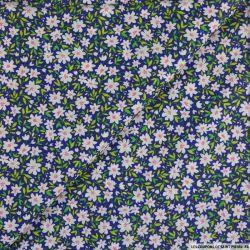 Coton imprimé marguerite fond bleu-violet
