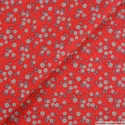 Coton imprimé pensée fleurie fond grenadine