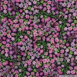 Coton imprimé libérer les fleurs rose fond noir