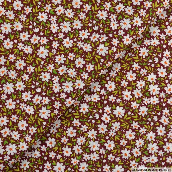 Coton imprimé marguerite fond bordeaux