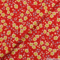 Coton imprimé chamboulement fond rouge