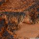 Fausse fourrure à poil long orange