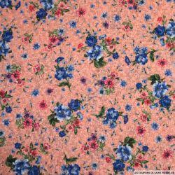 Maille imprimée fleurs bleu et rose fond saumon
