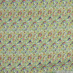 Satin imprimé floral fond vert amande