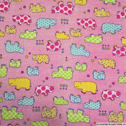 Flanelle de coton imprimé hippopotame fond rose