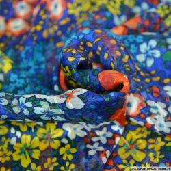 Satin dévoré lurex imprimé capucine fond bleu