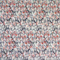 Mousseline imprimée spray bleu et rouge fond blanc