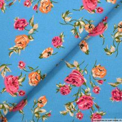 Satin de coton imprimé douce rose fond bleu
