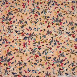 Gaze polyester imprimée oiseaux fond saumon