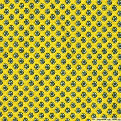 Coton imprimé malva sylvestris fond moutarde