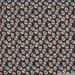 Coton imprimé tête de mort hippie fond gris