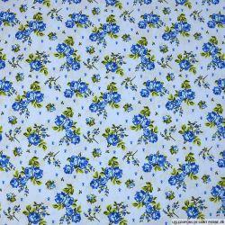 Coton imprimé poétique fond bleu