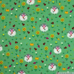 Coton imprimé mouton jardinier fond vert