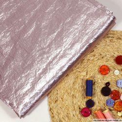 Tissu polyester lamé rose pâle
