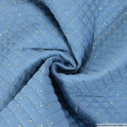 Double gaze matelassé bleu confettis doré vendu au mètre