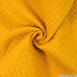 Double gaze matelassé jaune moutarde confettis doré vendu au mètre