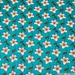 Coton imprimé fleur grimpante blanche fond turquoise
