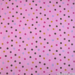 Coton imprimé soleil graphique fond rose foncé
