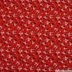 Coton imprimé pas de chichi fond rouge