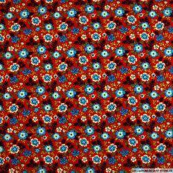Coton imprimé attrape regard fond rouge