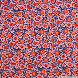 Coton imprimé attrape regard fond rose