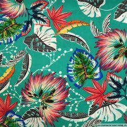 Crêpe polyester imprimé voyage sans retour fond turquoise