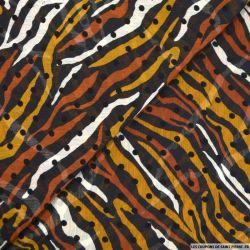 Mousseline imprimée floqué pois tigrou orange fond noir