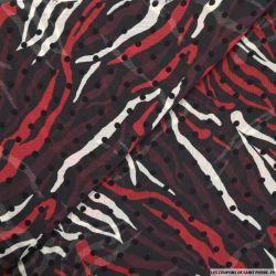 Mousseline imprimée floqué pois tigrou rouge fond noir