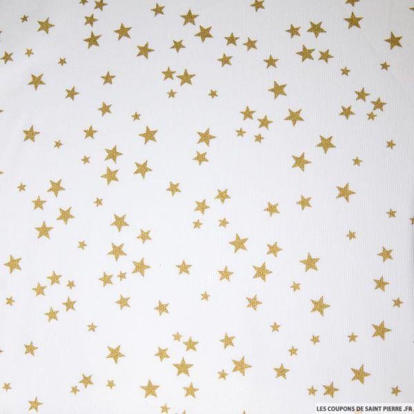 Tissu Piqué de coton imprimé étoiles dorées