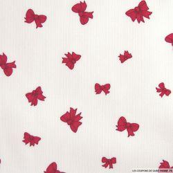 Tissu en piqué de coton imprimé noeuds couleur framboise