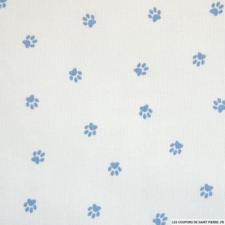 Tissu Piqué de coton imprimé pattes de chien bleues sur fond blanc