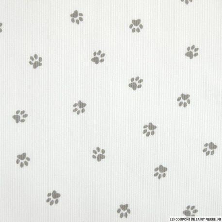 Tissu Piqué de coton imprimé pattes de chien grises sur fond blanc