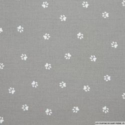 Tissus Piqué de coton imprimé pattes de chien blanches sur fond gris