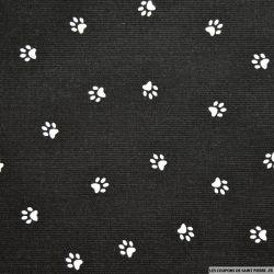 Tissus Piqué de coton imprimé pattes de chien blanches sur fond noir