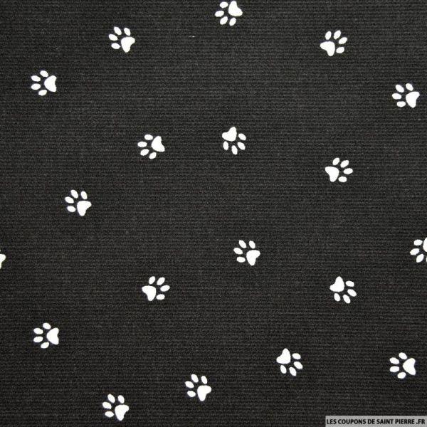 Tissu Piqué de coton imprimé pattes de chien blanches sur fond noir