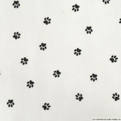 Tissus Piqué de coton imprimé pattes de chien noires sur fond blanc