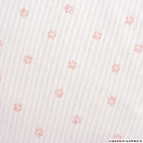 Tissu Piqué de coton imprimé pattes de chien roses sur fond blanc