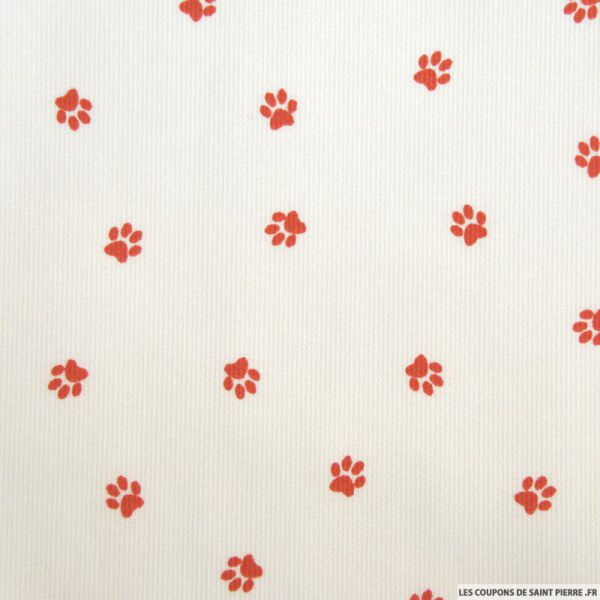 Tissu Piqué de coton imprimé pattes de chien rouges sur fond blanc
