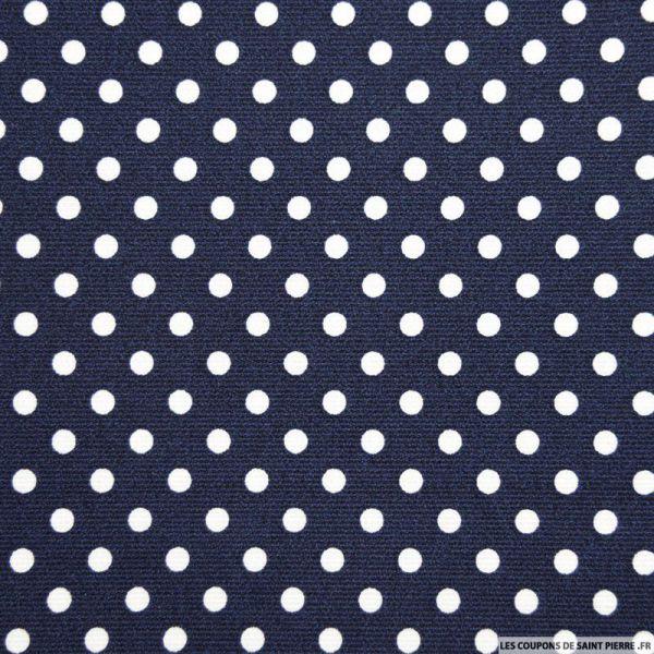 Tissu Piqué de coton pois blancs sur fond bleu marine