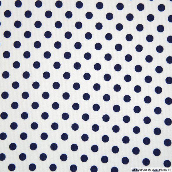 Tissu Piqué de coton milleraies imprimé pois bleu marine sur fond blanc