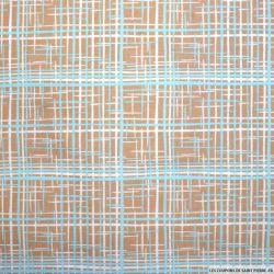 Coton imprimé graphique marron et bleu